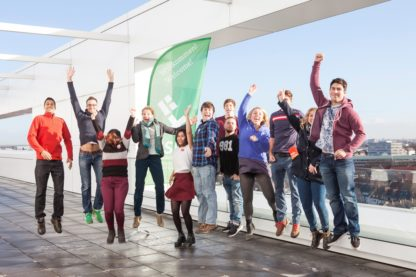 Jumping exchange students of the Hochschule Bremen on a high building